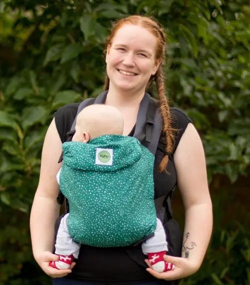 Kahubaby sling being worn in a front carry on a woman