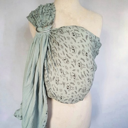 Melliapis ringsling on a mannequin in blue with a sloth print