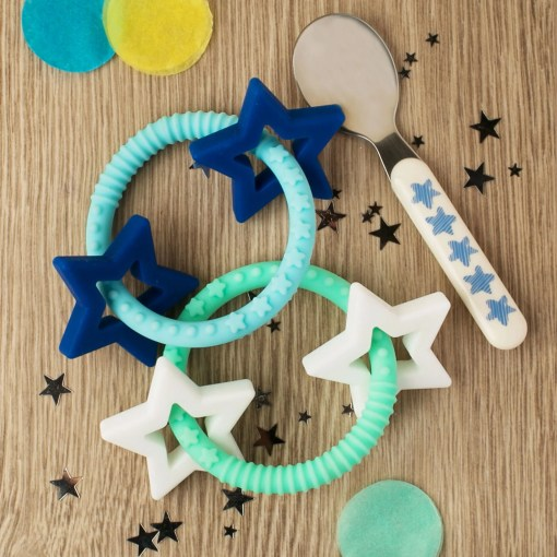 Photo of two star teethers on a wooden background