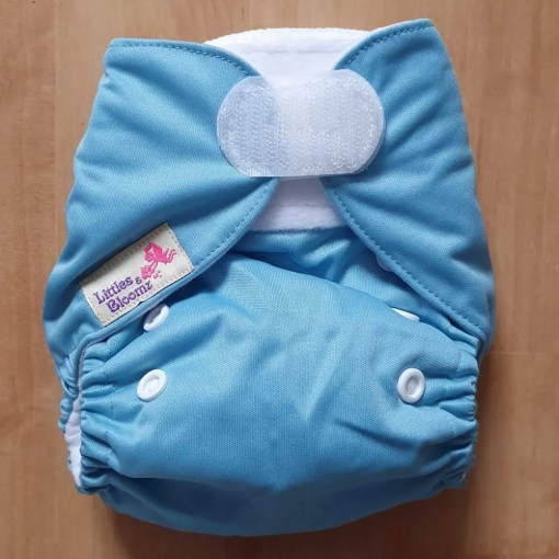 Light Blue Littles & Bloomz newborn nappy