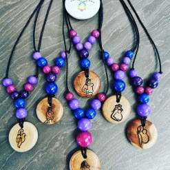 Group shot of juniper babywearing necklaces