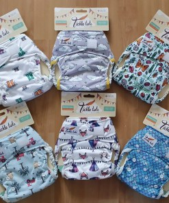 Group shot of 6 nappies in a range of prints