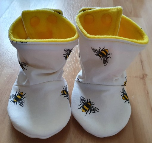 White boots with bee design