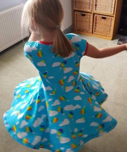 Action shot of a child spinning around in the Twirly Dress