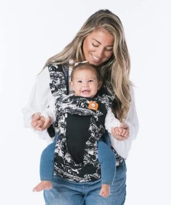 Woman holding baby in a world-facing position sling