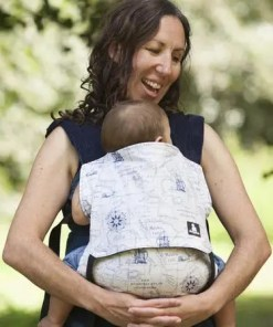 Angeline carrying baby in the Spirit of Adventure baby carrier