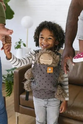 Girl wearing her teddy in a Tula Mini sling (Mason)