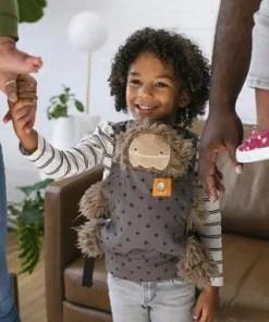 Girl wearing her teddy in a Tula Mini sling (Mason)