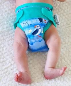 Newborn wearing a Close Pop-in Puffin Newborn Nappy