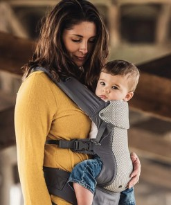 Woman holding baby in a cool mesh version of the Beco Gemini