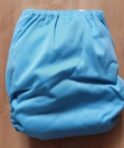 Rear of Light Blue Littles & Bloomz newborn nappy