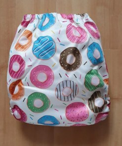 Rear view of Donut print Littles & Bloomz newborn nappy