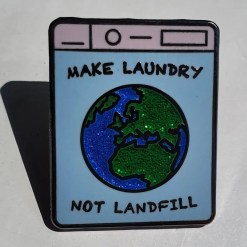 Close up of Make Laundry Not Landfill pin badge