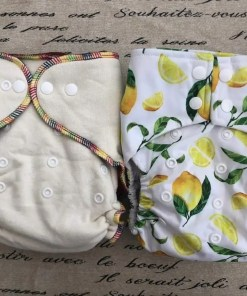 Hemp and Bamboo Fitted Nappy (L) and Simply The Zest BTP Nappy
