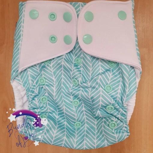 Light green chevron print nappy with white tabs