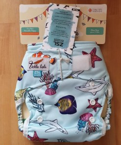 Pale blue nappy with colourful ocean animal print
