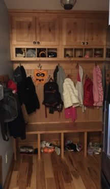 The mudroom was also a huge improvement, with cubby storage for boots and shoes, a bench for taking off footwear, easy to hang hooks for kid's coats, and upper, closed storage for off-season items. This was all finished off in a beautiful, hickory wood built-in unit, giving it all some enclosure and structure.