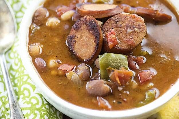 This slow cooker soup recipe starts with a bag of dried beans and ends up as a perfectly seasoned Cajun soup with Andouille sausage and tender beans.