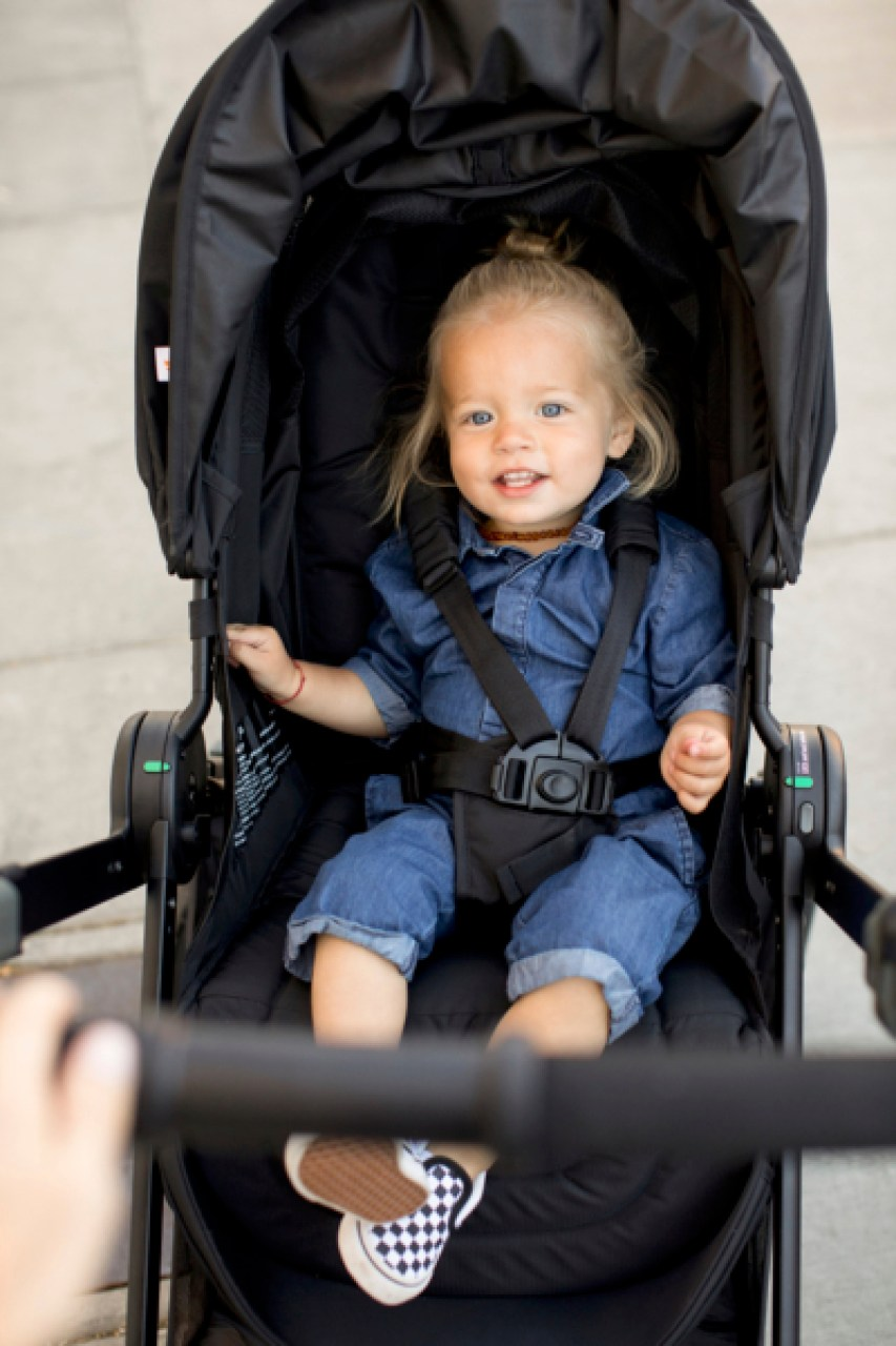 A 14 month old baby in an Ergobaby 180 Reversible Stroller