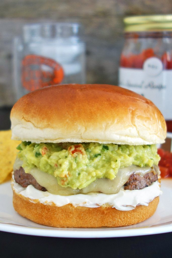 Guacamole burger topped with fresh quac, sour cream, and pepper jack cheese