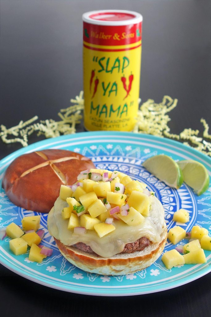 The Islander Burger combines sweet mango salsa and spicy cajun seasoning.