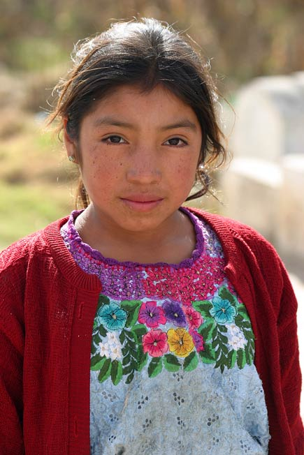 girl with embroidered blouse in momostenango, guatemala