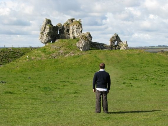 Daniel Burke standing in front of the ruins of Cluain Mhic Nóis. Co. Affaly, Ireland.