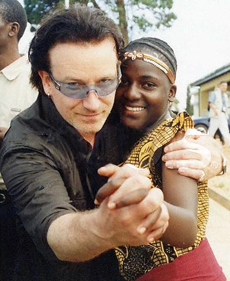 IRISH ROCK SINGER BONO DANCES WITH AN ORPHAN LIVING WITH HIV/AIDS