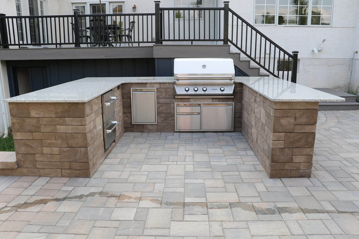 outdoor kitchen bar reclaimed wood cabinets custom built kitchens grills burkholder landscape techo bloc with counter height trash grill and storage drawers