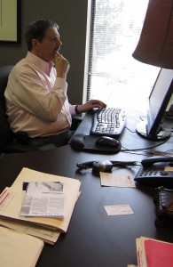 A knowledge economy at work.  Gregory spends as much time at a keyboard as he does promoting Burlington.