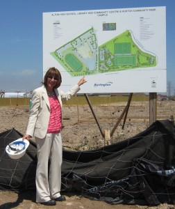Cindy Mercanti stands before the bill board that shows what is about to be built on the site north of Dundas and West of Walkers Line.  Major change for that part of Burlington.
