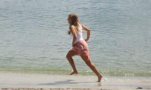 Woman running on mini beach