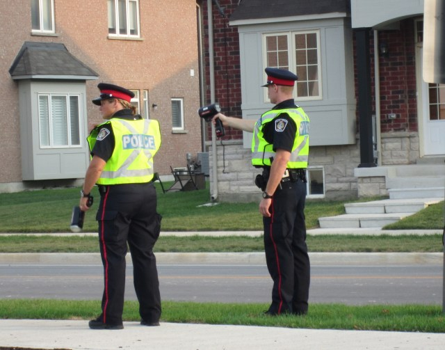 Police with radasr guns at Alton two officers