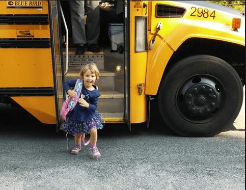 Child getting off school bus