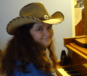 Hayley Varall - sweet smile at piano