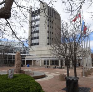 city hall with flag poles