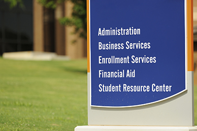 Administration, business, and student related enrollment services sign on campus.