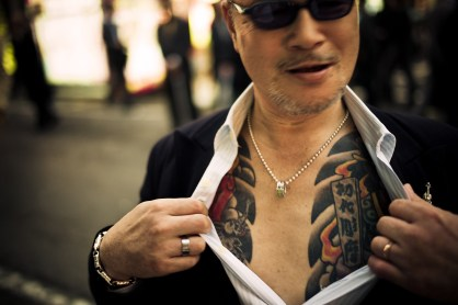 Street fighter showing off his tattoo in Kabukicho, Shinjuku, Tokyo - 2010