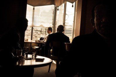 The two righest ranking bosses in the Odo family, having coffee at a hotel bar, after it has been completely cleared first for safety reasons. Here they are flanked by several strategically positioned bodyguards - 2009