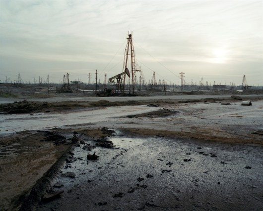 Socar state oil fields Ramana, Absheron Penninsula, Azerbaijan. The history of oil in the Caspian is long standing. Wells were being hand-dug in the region as early as the 10th century and the world's first offshore and machine drilled wells were built on the Absheron peninsula during the 1870s.