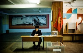 The day of the Parliamentary elections in a village around Bishkek. The elections contained many irregularities. The entire opposition got only seven seats out of 89, with the largest opposition party not winning any seats.