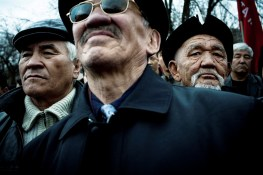 Kyrgyz Men take part in a demonstration against President Kurmanbek Bakiev in Bishkek, on the 27th of march 2009.