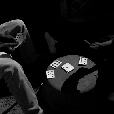Men play cards and gamble in Diepsloot