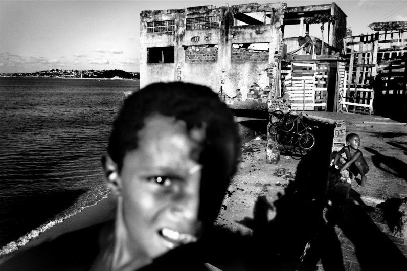 Children in the abandonated chocolate factory. Currently are more than 100 families living inside. These families were looking for a decent place to live and a more prosperous future for their children, away from the dangerous streets of Salvador de Bahia in Brazil.