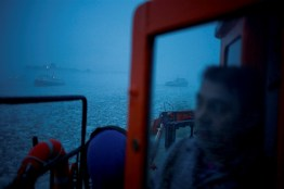 "Szczecin, Poland. Czeslaw Mazur a mechanic onboard an icebreaker ""Wilk"" (Wolf) observes other icebreakers in action."