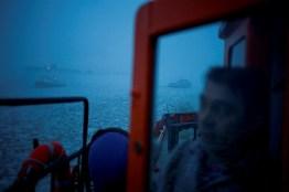 """Szczecin, Poland. Czeslaw Mazur a mechanic onboard an icebreaker """"Wilk"""" (Wolf) observes other icebreakers in action."""