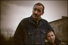 Armen, a veteran with his son in the city of Shusha.