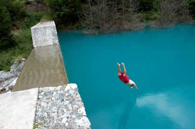 A man jumps into a lake in the Jiuzhaigou National Park in Sichuan Province.