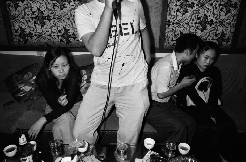 Two couples double-date at a karaoke club in Jishou City, China 2006.