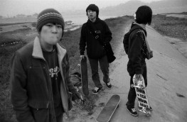 Skateboarders congregate in a drainage ditch along the Xiang River in Changsha, China 2007.